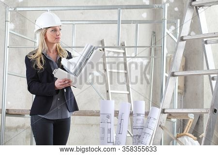 Woman Architect Or Construction Interior Designer With White Windows Cutaway Profile Inside A Buildi