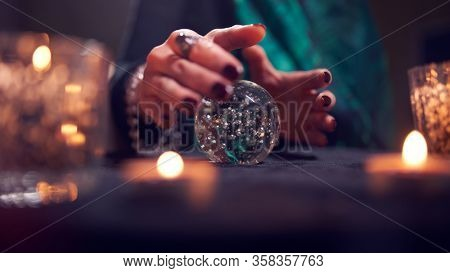 Fortuneteller woman's hands with predictions ball