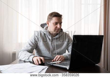 Young Man Switched To Telework Due To Quarantine Of Coronovirus Pandemic Covid-2019. Remote Work At