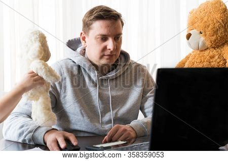 Young Man In Sports Hoody At Telework Due To Home Quarantine Of Coronovirus Pandemic Covid-2019.chil
