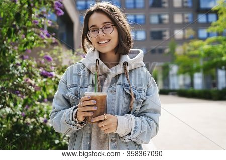 Lifestyle, Leisure And Outdoor Activity Concept. Portrait Of Happy Queer Girl In Denim Jacket And Gl