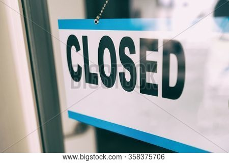 Closed sign on retail business store window because of COVID-19 Pandemic outbreak. Government shutdown of restaurants, shopping stores, non essential services.