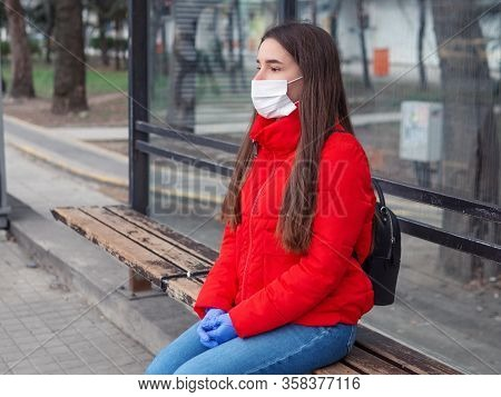 Virus Mask. Asian Woman Traveling Waiting For The Public Transportation Wearing Face Protection Surg