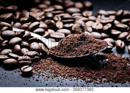 Ground Coffee Background. Obligatory Morning Hot Caffeine Drink Backdrop. Coffee Powder Metal Spoon.