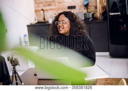 Mirthful Woman At Home Smiling In The Kitchen Stock Photo