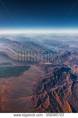 Aerial View From An Airplane. Flying Above Beautiful Land At Sunrise.