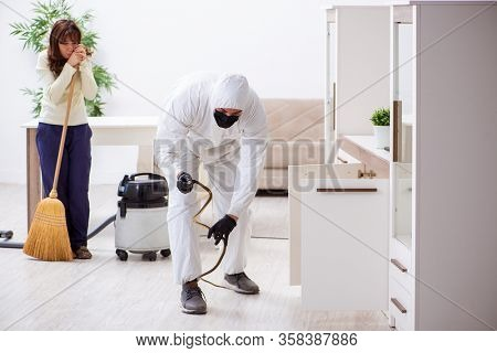 Young male contractor exterminating snakes in the flat