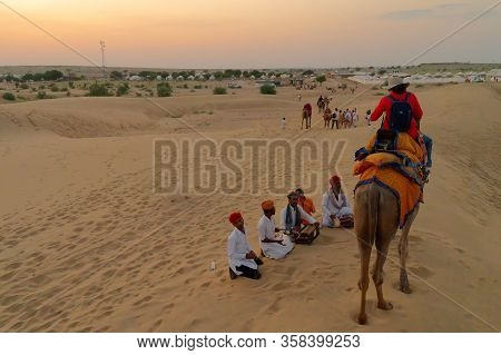 Thar Desert, Rajassthan, India - October 15th 2019 : A Female Tourist Interacting With Local People