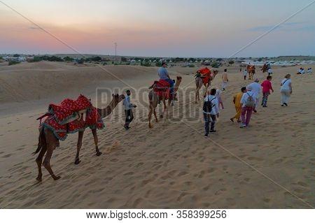 Thar Desert, Rajassthan, India - October 15th 2019 : Tourists Riding Camels At Sand Dunes Of Thar De