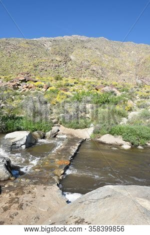 Tahquitz Creek with bridge and trail. Tahquitz Canyon is one of the most beautiful and culturally sensitive areas of the Agua Caliente Indian Reservation.