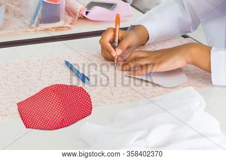 Close-up. Mask Fabric Striped Point Red White Homemade On Table. Prevent Coronavirus Or (covid-2019)