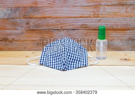 Mask Fabric Striped Blue - White Homemade And Hand Wash Gel On Table. Prevent Coronavirus Or (covid-