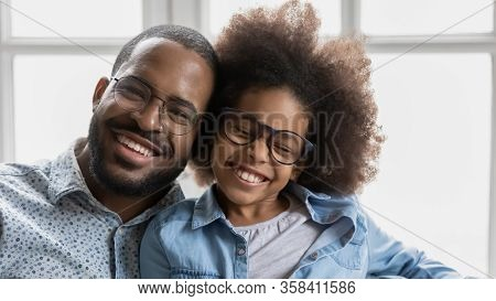African Father Little Daughter In Glasses With Toothy Smile Portrait