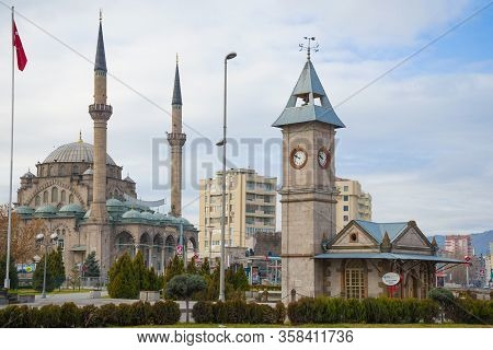 Kaiseri, Turkey - January 04, 2015: View Of The Clock Tower And The Burunguz Camii Mosque On A Janua