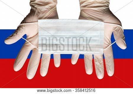 Nurse Holding Respiratory Face Mask In Hands In White Gloves On Background Flag Of Russian Federatio