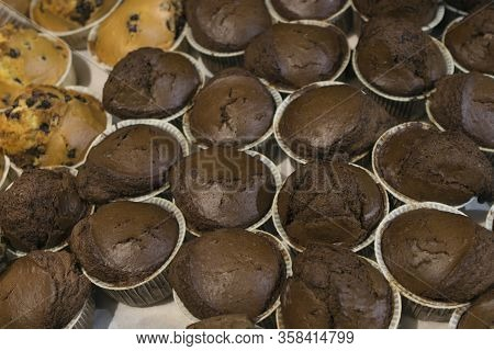 A Lot Of Chocolate Muffins In A Bakery Shop Window