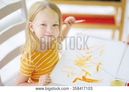 Cute Girl Drawing With Colorful Paints. Creative Kid Painting At Home. Education And Distance Learni