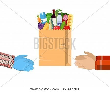 Safe Contactless Delivery Of Goods To Buyer. Hands Hold Paper Shopping Bag Full Of Groceries Product