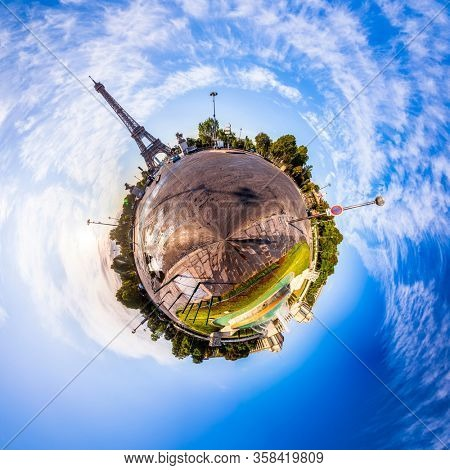 Miniature tiny planet of Scenic panorama of the Eiffel Tower in Paris, France. 360 degree panoramic view