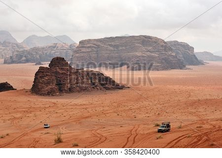 Wadi Rum Rock Desert. Wadi Rum Is A Valley Cut Into The Sandstone And Granite Rock In Southern Jorda