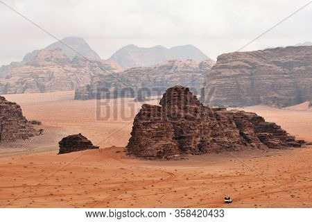 Wadi Rum Rock Desert - Close Up Surface. Wadi Rum Is A Valley Cut Into The Sandstone And Granite Roc
