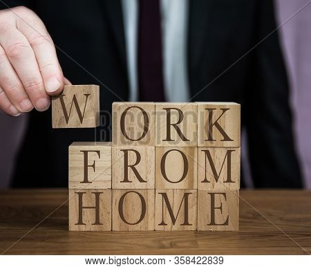 A Safety Message From A Businessman To All Workers To Follow Guidlines And Work From Home During The