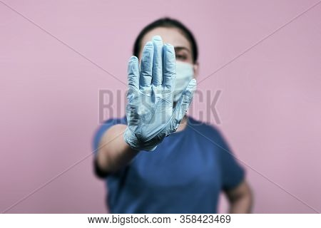 Woman Showing Stop Hand-gesture. Stop Coronavirus. Stop Sign With Hand. Stop Spreading Covid-19 Or C
