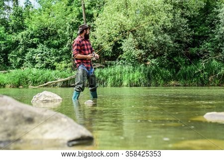 I Choose My Passion. Man Catching Fish. Mature Man Fly Fishing. Fisherman Show Fishing Technique Use