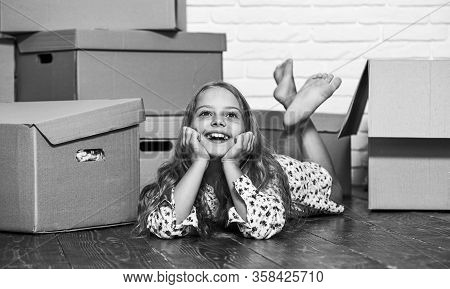 Dreaming About Own Room. Girl Small Child And Boxes. Move Out Concept. Prepare For Moving. Rent Hous