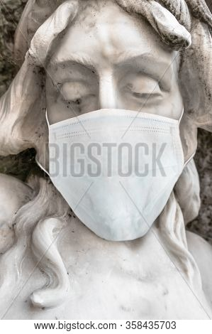 Jesus Christ Statue With Medical Mask. Covid-19 In The World. For Coronavirus Epidemic Concepts.