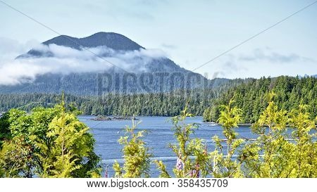 Beautiful Seascape Of The Bay On The Vancouver Island. The Blue Sea And Coniferous Forest, Mountains