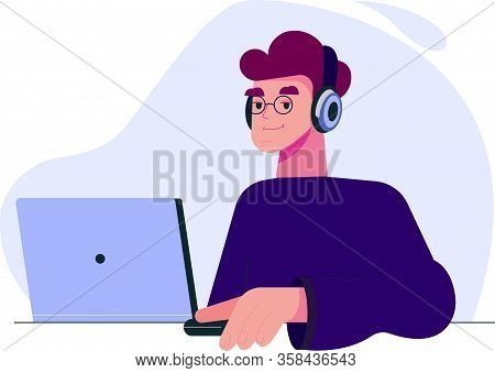 A Young Man Works Remotely At A Laptop