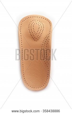 Isolated Orthopedic Insole On A White Background. Treatment And Prevention Of Flat Feet And Foot Dis