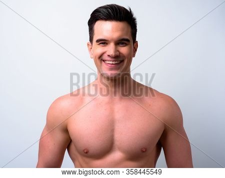 Face Of Happy Young Handsome Muscular Man Smiling Shirtless