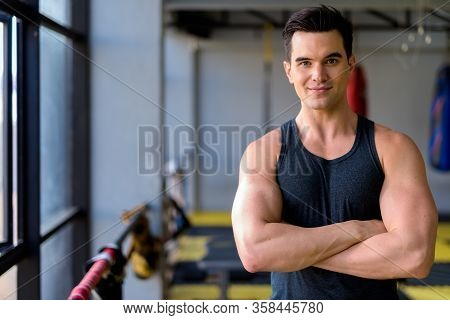Young Handsome Man With Arms Crossed At The Gym