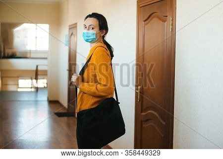 Woman With Face Mask Going Home. Global Pandemic. Work From Home During Coronavirus Quarantine.