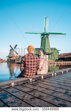Couple Men And Woman On Vacation In The Netherlands Visit Zaanse Schans Zaandam Netherlands, Zaanse