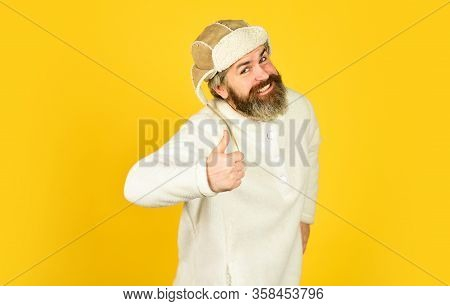 Natural Sheep Fur. Waiting For Warming. Spring Is Coming. Bearded Man Wear Hat With Ear Flaps. Furry