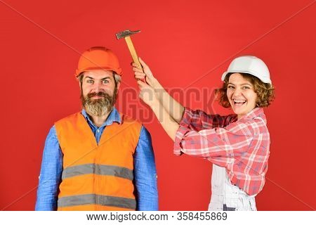 Rub In. Couple Knocking Head With Hammer. Clearly Explain. Intelligibly Concept. Couple Renovating A