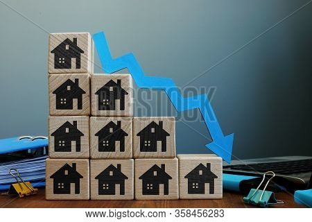 Real Estate Price Reduction. House Value Falling.
