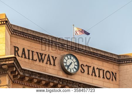 Adelaide Railway Station Building Facade With Clock At Sunset