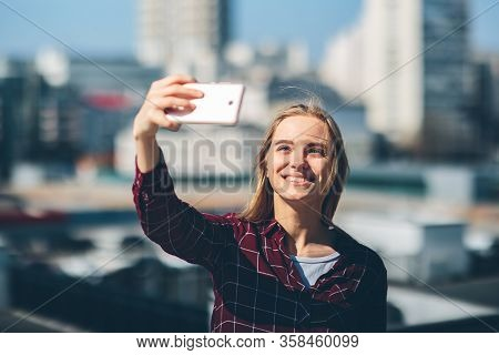 Pretty Woman Taking A Selfie. Beautiful Girl Walking On The Streets And Photographing Some Landmarks