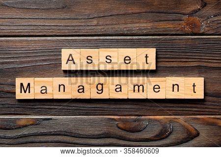 Asset Management Word Written On Wood Block. Asset Management Text On Wooden Table For Your Desing,