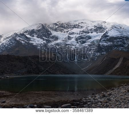 Huamantay Lake With Snowcapped Huamantay Mountain In The Background, Salkantay Trek, Peru