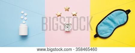 Pills, Bottle, Sleeping Mask And White Alarm Clock With Stars On Pink, Yellow, Blue Art Background.