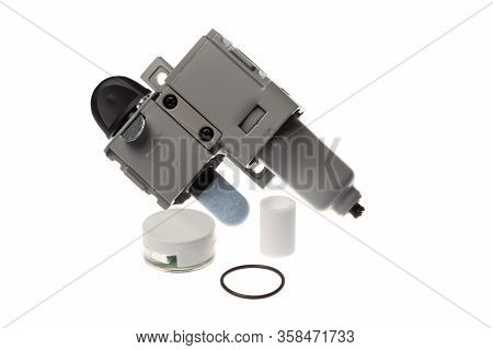 Steel Compressed Air Filter With On Off Know With Attached Silencer Next To A Spare Parts Kit Contai
