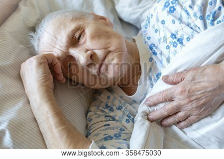 Sick Elderly Caucasian Woman In Bed With Flu Symptoms. Quarantined During  Virus Outbreak. Concept -