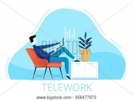 A Young Male Freelancer Sits In A Chair And Works Remotely From Home. The Concept Of Telework During