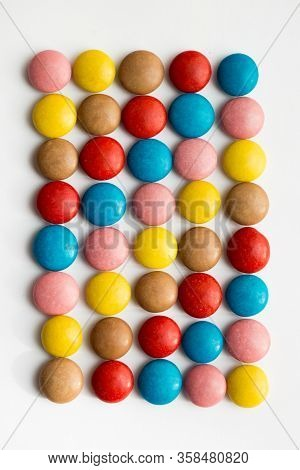 Close Up Of A Pile Of Colorful Chocolate Coated Candy, Chocolate Pattern, Chocolate Background.