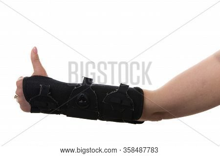 Close  Up Of Woman Hand In  Orthosis Isolated On White Background